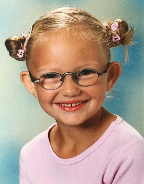 Before this grinning girl was flashing her million dollar smile as a supermodel, she was just another cute kid with dimples and spectacles growing up in Zoetermeer, Netherlands. Can you guess who she is?