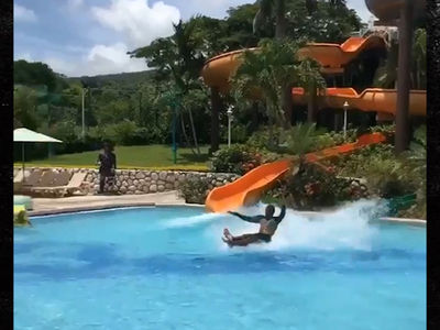 Water Slide Guy Sticks Landing by Gliding Over Water! (VIDEO)