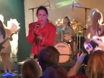 Corey Feldman Knocks His Tooth Out with Microphone, Fan Finds it for Him