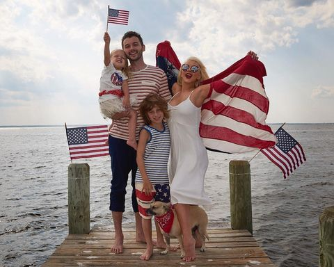 Christina Aguilera posted an adorable pic with her family, American Flag billowing in the wind