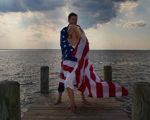 Christina Aguilera got close with her man wrapped in the American Flag