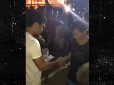 Manny Pacquiao Hands Money to Filipino Kids, 'This Is Why I Fight'