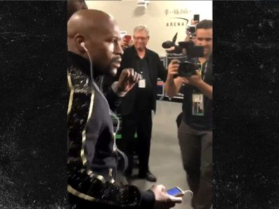 Floyd Beats Conor to Arena, Rocking Track Suit DRIPPING in Gold