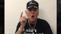 Ric Flair Lets Fans Know He 'Ain't Dead Yet' and is 'Back Up and Running'