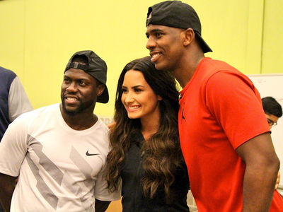 Demi Lovato Volunteers in Houston with Kevin Hart & Chris Paul