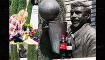 Lakers' Jeanie Buss Visits Father's Grave With Coca-Colas