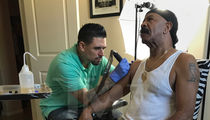 Drake's Dad Inks Monster Tattoo of Drake's Face on His Arm