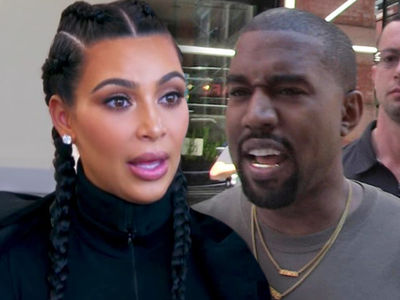 Kim Kardashian and Kanye West Hit in Car Theft