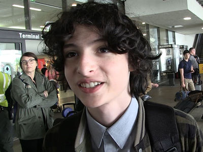 'Stranger Things' Star Finn Wolfhard Talks Kissing Millie Bobby Brown