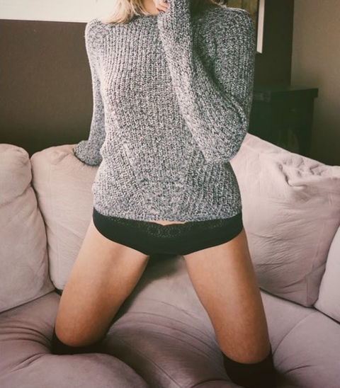 Guess the cozy babe in a big sweater!