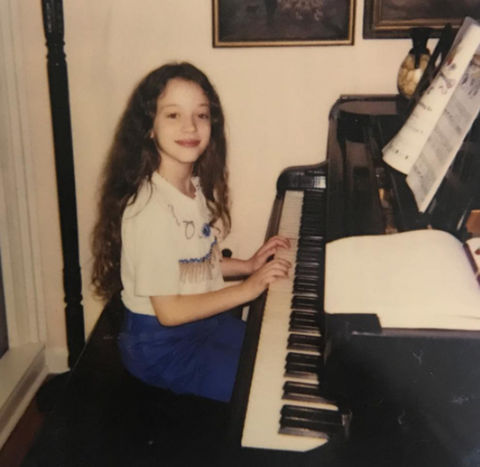 Before this mini musician had an infinite playlist, she was just another kid on the keys growing up in Bryn Mawr, Pennsylvania.