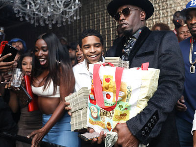 Diddy Blows $100k at Ace of Diamonds Strip Club, Son and T.I. Help