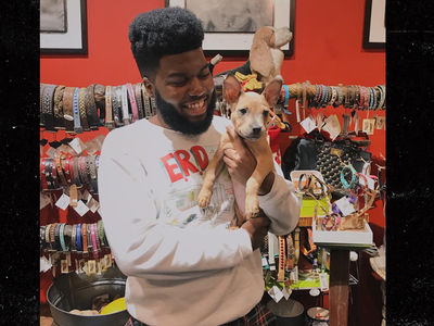 Khalid Jumps Through Hoops to Adopt His New Puppy