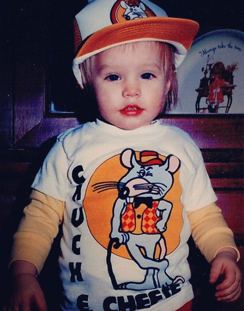 Before this blue-eyed baby was working for Mickey Mouse, she was just another cute kid living the Chuck E. Cheese life in Detroit, Michigan.