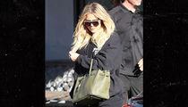Khloe Kardashian Hides Baby Bump Behind Purse and Under Loose Sweater