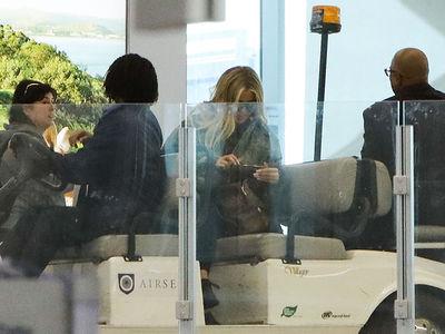 Khloe Kardashian Hides Baby Bump and Rides Golf Cart at LAX