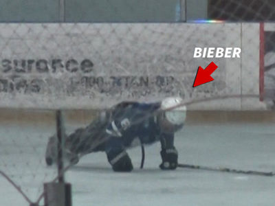 Justin Bieber Falls at Hockey Rink, Makes the Most of It