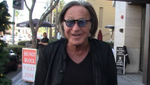 Mohamed Hadid Is Proud of Bella's Sexy LOVE Shoot, But He's Not Looking