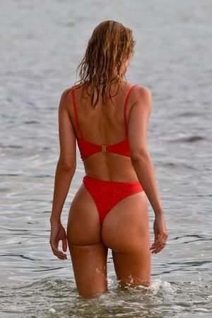 Kimberley Garner hits the beach in the Caribbean for Christmas in the sun