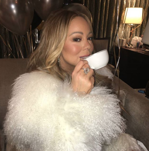 Mariah Carey celebrating with some tea after her NYE performance