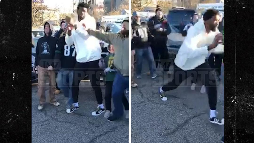 155bfdf59 Philadelphia 76ers' Joel Embiid Shoves Eagles Fan During Tailgate ...