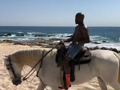 Floyd Mayweather Channels Inner Putin for Topless Horse Ride