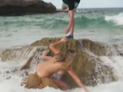 Kate Upton Swept Off Her Feet During Topless SI Swimsuit Shoot