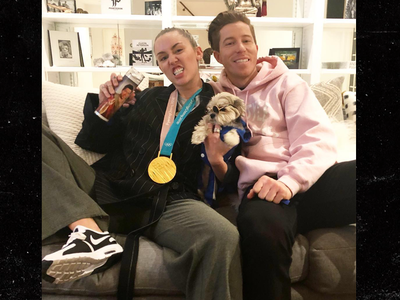 Miley Cyrus Proudly Wears Shaun White's Gold Medal
