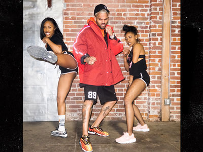 Chris Brown Surprises Women's Dance Class, Hooks Them Up with Swag
