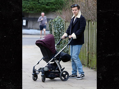 Harry Styles Smitten with Baby as He Pushes Stroller Down London Streets