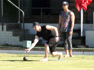 Nick & Joe Jonas Try Their Hands at Lawn Bowling in Australia