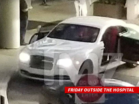 Rick Ross's family and entourage arriving to near Miami hospital.