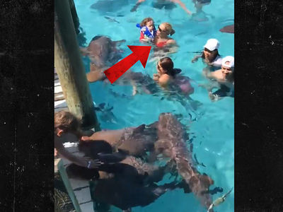 Coco Takes 2-Year-Old Daughter Chanel Swimming with Sharks