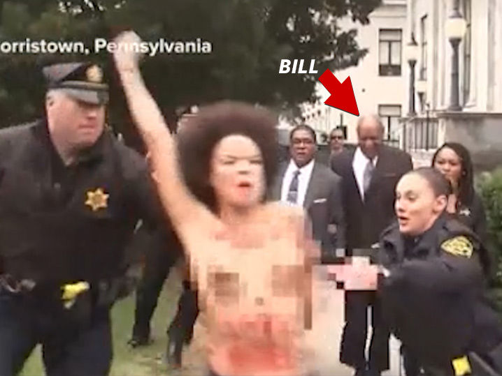Topless Protester Charges Bill Cosby on His Way into Court  837fae200