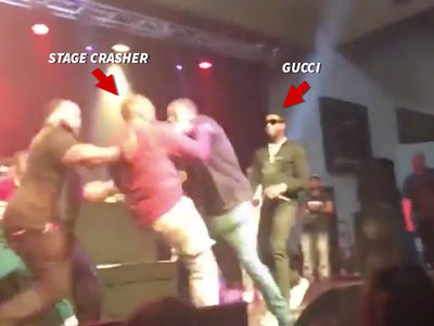 Gucci Mane's Road Manager Body Checks Stage Crasher at Concert