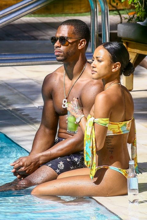 Karrueche Tran and Victor Cruz can't keep their hands off each other at their pool in Miami. The duo are seen sticking very close as they enjoy their vacation at the Setai Beach Hotel.