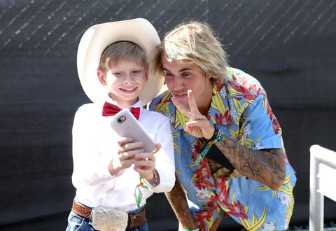 Viral internet sensation Mason Ramsey aka The Walmart Yodeling Boy, (L) and Recording Artist Justin Bieber pose for a selfie backstage during the 2018 Coachella Valley Music And Arts Festival April 13, 2018 in Indio, California.