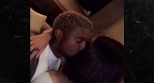 Kim Kardashian and Kanye West in Rare PDA Moment