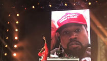 Nipsey Hussle Performs 'F*** Donald Trump' with Kanye's MAGA Photo