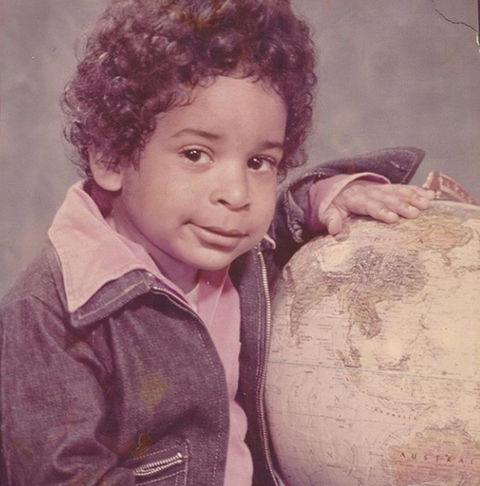 Before this curly-haired cutie was cracking jokes around the globe, he was just another worldly young man growing up in sunny California.