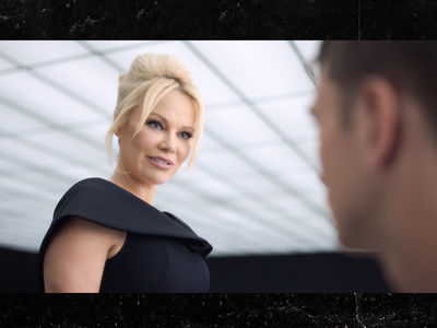 Pamela Anderson Slams Ride-Hail Apps With New Batman-Inspired PSA