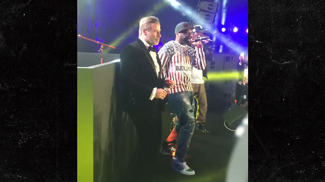 Image result for John Travolta Dances on Stage with 50 Cent at Cannes