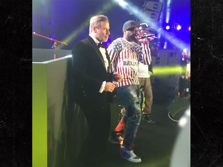John Travolta Dances on Stage with 50 Cent at Cannes