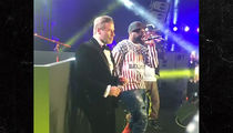John Travolta Dances Onstage with 50 Cent at Cannes