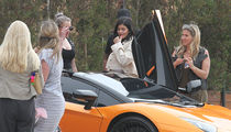 Kylie Jenner Leaves Lunch in Malibu in Orange Ferrari