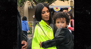 Kim Kardashian Stands Out at Disneyland with Her Kids