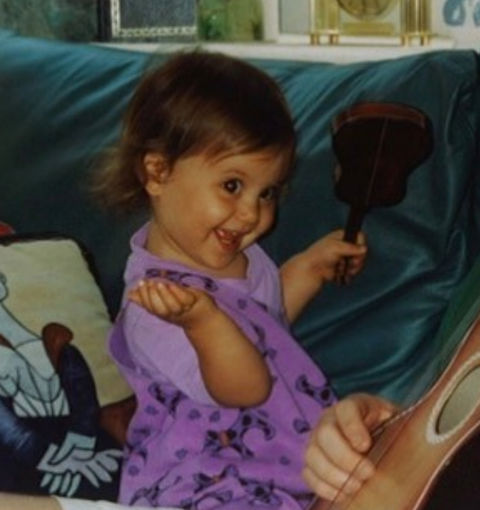 Before this beautiful baby had no tears left to cry, she was just another sweetheart with a string instrument putting on a show in Boca Raton, Florida.