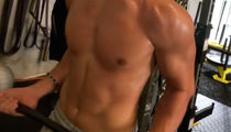 Guess Which Hot Singer is Showin' Off His Shredded Abs!