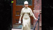 Lady Gaga Steps Out In Jockey Helmet