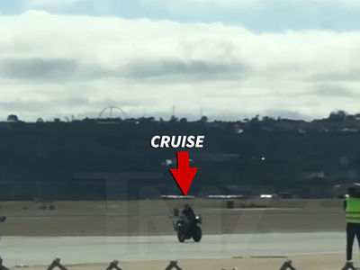 Tom Cruise Rides Motorcycle on Set as 'Top Gun 2' Filming Begins